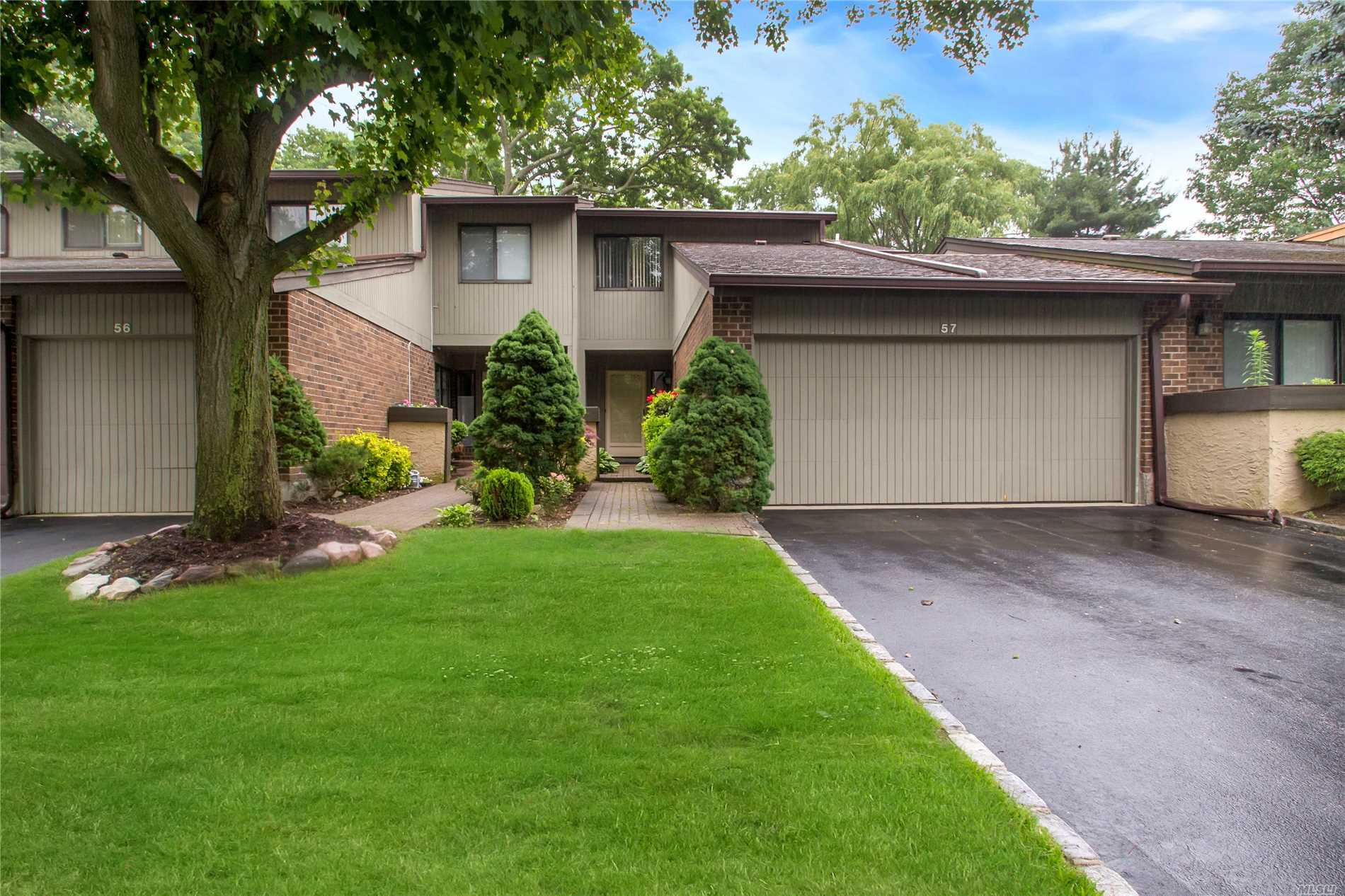 Located In The Back Of The Community With Year Round Vistas Of Greenery, Sits This Three Bedroom And Two And A Half Bath Condo With Updated Kitchen And Baths, Fireplace, Wood Floors And Cathedral Ceilings. Can Be In For The New School Year.