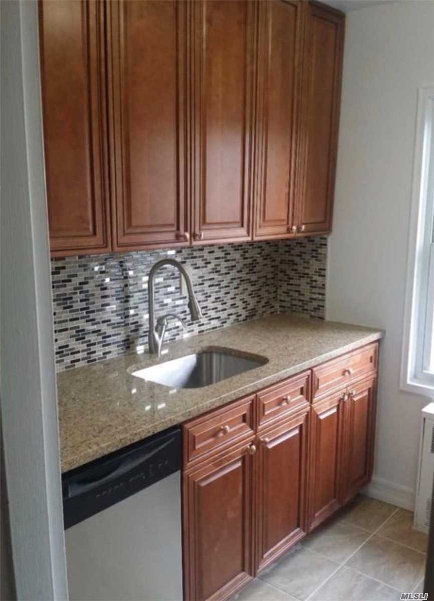 Unique And Fully Renovated This One Bedroom, One Bath Co Op Has Wood Floors Throughout. Relax And Unwind On The Very Large Rear Facing Terrace. Parking Is A Breeze In Your Own Private Single Car Garage With Shelving & Plenty Of Space For Extra Storage. Close To Lirr, Restaurants, Shopping & Houses Of Worship. Welcome Home!!!