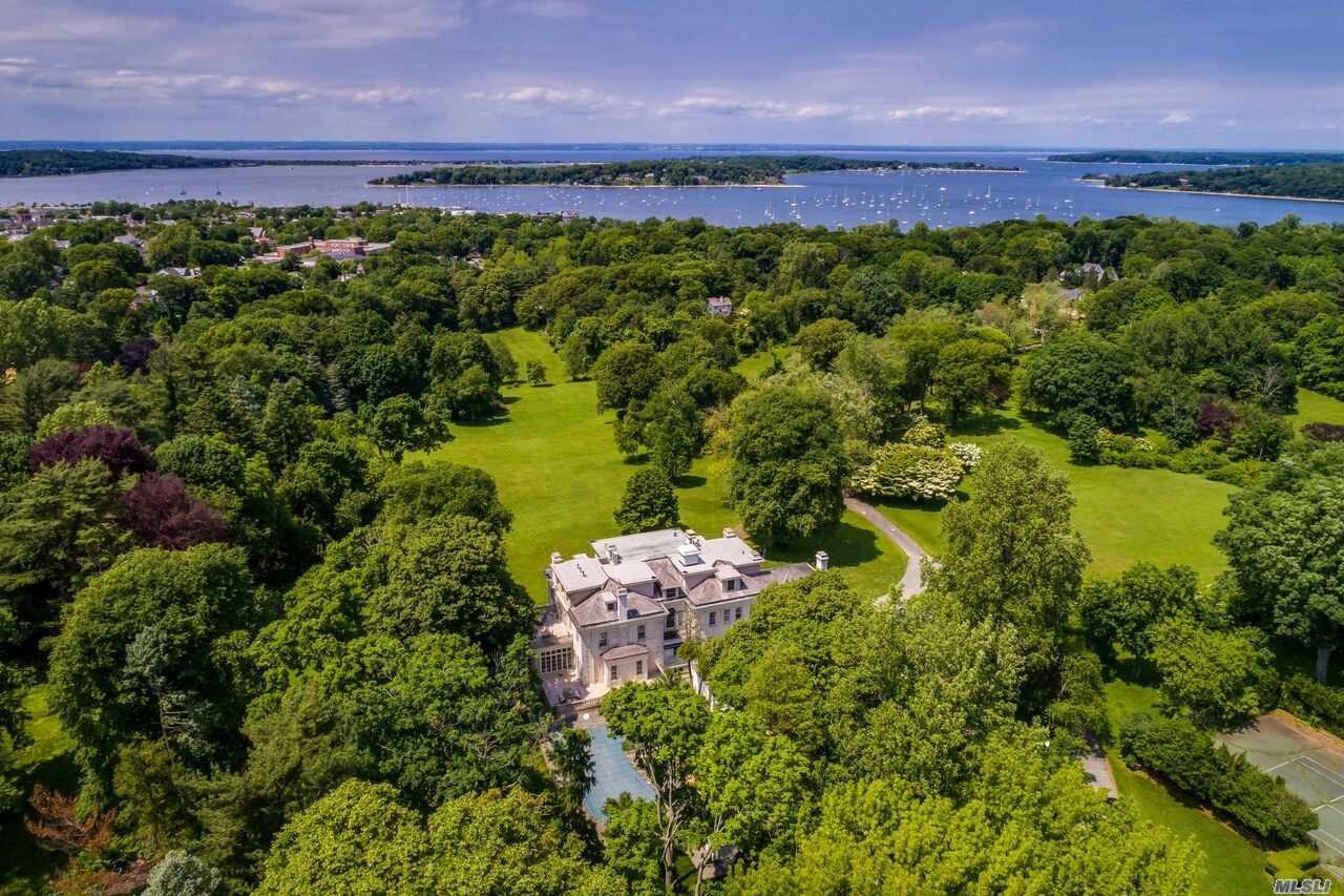 'Moorelands' Grand Brick Charles Berg Designed 1915 Italian Renaissance Style Gold Coast Estate W/ Waterviews Of Oyster Bay Harbor. Gorgeous 43.5 Acres Of Open Fields And Rolling Hills. Magnificent Stately Rooms With Intricate Moldings, Plaster Work, Stunning Fireplaces. Resort Like Pool/Cabana. Pond, Tennis Court, 2 Barns. Large Carriage House With 4 Apartments (8Br, 5Bath, 4Kit). Possible Subdivision (2 Acre Zoning).