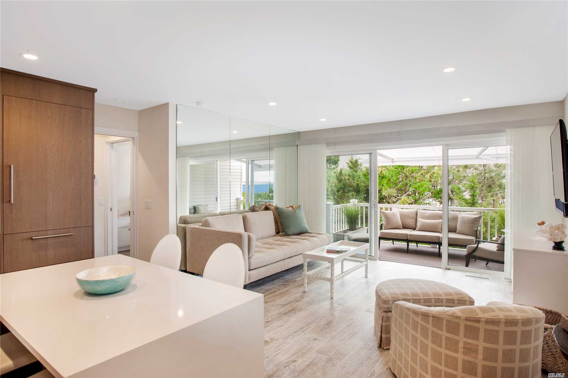 In Between The Multi- Million Dollar Homes On The Pristine Stretch Of Beaches On Dune Road, Is A Completely Renovated Super Chic 1 Bedroom W/Waterviews In The Sought After, La Coquille. Enjoy Concierge Services,  Heated Ocean Front Pool, Beach And Bayside Sunsets. All Within A Short Distance Into Town! The Easy Breezy, No Traffic Part Of The Hamptons! ***Renovated Form The Studs, Custom Cabinetry, Roll Out Awning On The Private Deck And More. Must See Before It's Sold!***