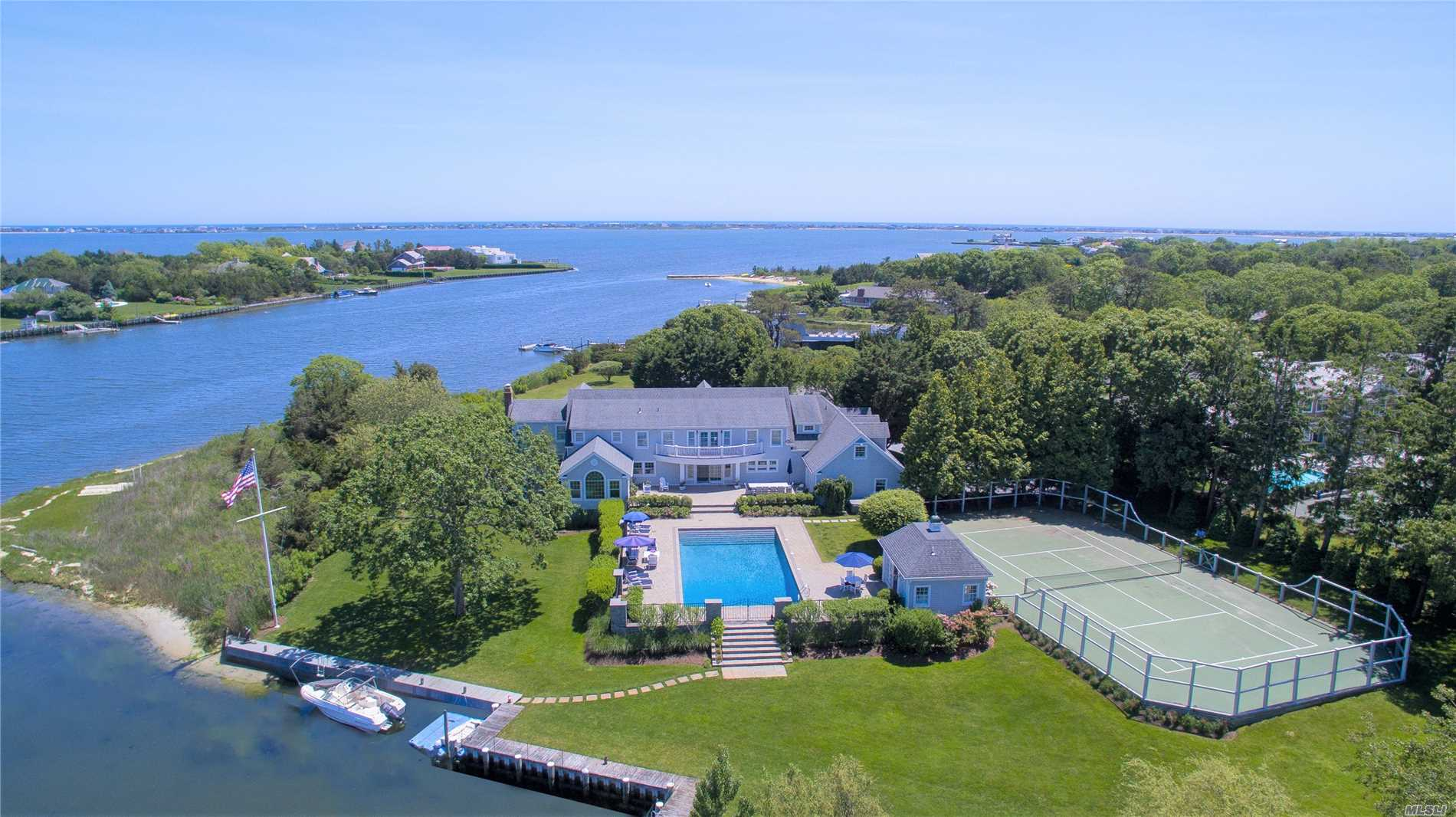 Water Views From Everywhere! Set On Over 2 Acres Down A Quiet Remsenburg Street, This Extraordinary Waterfront Property Offers A First-Floor Master Suite, Modern Kitchen, Waterfront Living And Dining Rooms, 4 Guest Bedrooms And Office/6th Bedroom. Oversized, Heated Gunite Pool, All-Weather Tennis Court, Pool House And So Much More!