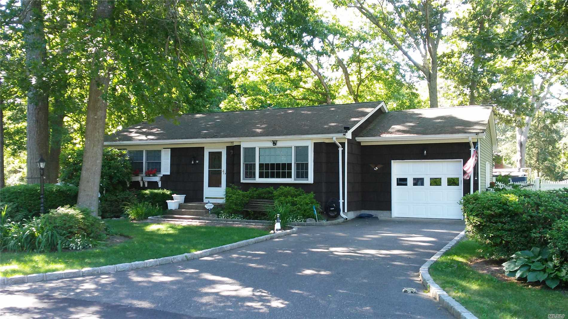Nicely Updated Home With Wood Floors, Updated Kitchen And Bath, Lovely Landscaping On A Dead End Street!!