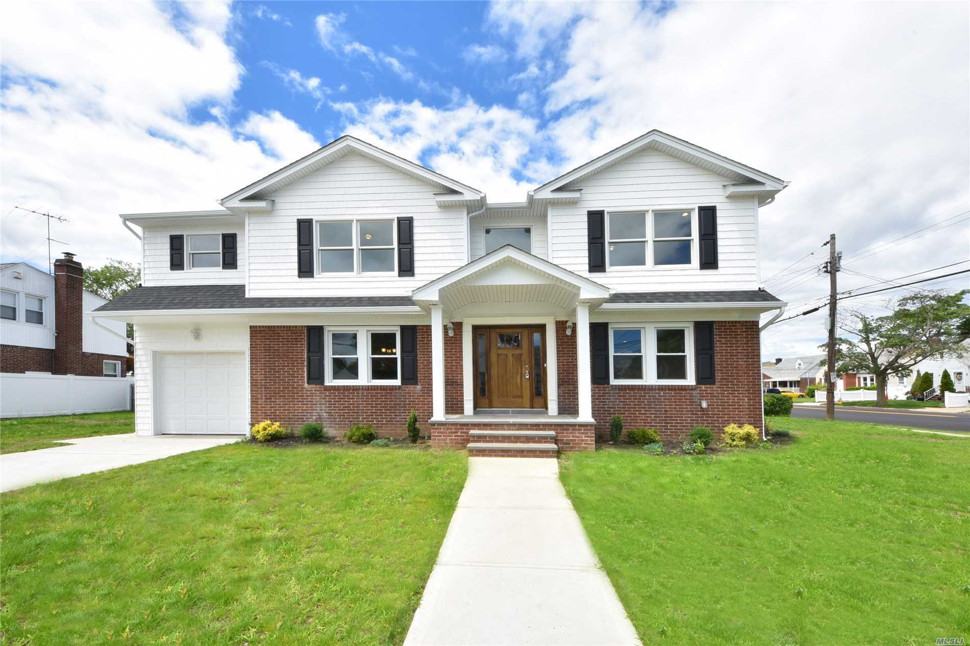 Totally Renovated From The Ground Up! This 5 Bedroom, 3.5 Bath Colonial Has An Open Floor Plan With Everything Any Buyer Could Want. Located Close To Parks, Shopping, And Transportation.