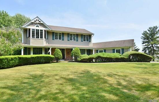 Beautiful 5 Bedroom Colonial On 1.2 Flat Tree Lined Acre. Updated Eat In Kitchen W/Granite Counter Tops, Stainless Appliances And Wood Floors, Family Room With Vaulted Ceilings & Fireplace. Wonderful Yard For Entertaining, Desirable Area In The Half Hollow Hills School District. Natural Gas Generator
