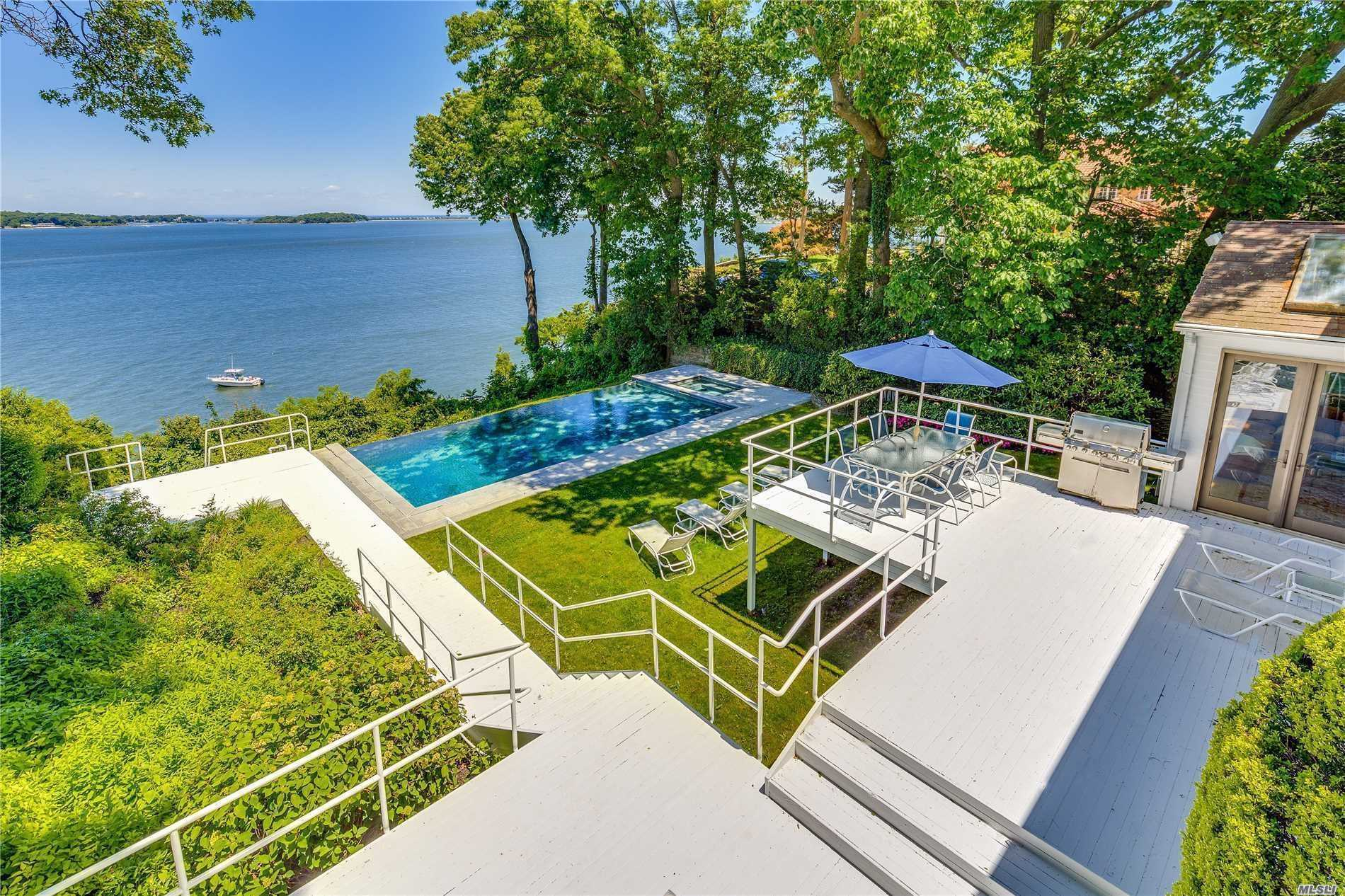 Overlooking Northport Bay, This Waterfront Post Modern Home Offers Dramatic Views W/ Many Vantage Points. Enjoy Each Sunrise From Most Every Rm W/ Soaring Windows Incl Mster Ste W/ Sauna, 2 Wic, & Balcony. Entertain Off Sleek Eik W/ Glass Doors Leads To Bi-Level Deck & Picturesque Gunite Infinity Pool/Spa. Step Down To Your Private Observation Deck For Some Fun On The Bay. Convenient Approx 1000Sqft Office/Guest Ste W/ Fpl. Perfect For Year-Round Enjoyment Or A Weekend Getaway, Only 1Hr To Nyc!