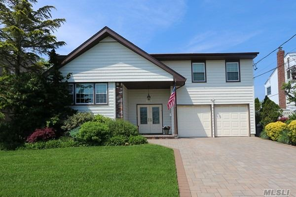 Redone 5 Bedroom, 2-1/2 Bath Chalet Splanch. New Eat In Kitchen With Granite, Jenn Air-Miele Appliances With Granite Counters, Baths With Granite. Updated Roof, New Window,  Heating System And Separate Water Heater. New Washer And Dryer, Front Redone. Slate On Main Level, Alarm And Generator. Just Move Right In!