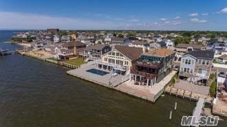 Location, Location! Magnificient Bayfront..A Masterpiece! Perfect For Entertaining...Inside And Out! Open Floor Concept! Floor To Ceiling Windows Overlooking The Great South Bay! Saltwater Pool, Outdoor Shower, Decks, 3 Car Garage! Enjoy Great Room, Frplc, Cac! Master Bdrm W/ Pvt. Bath! You Must See It To Believe It! Here Is Your Dream Home!