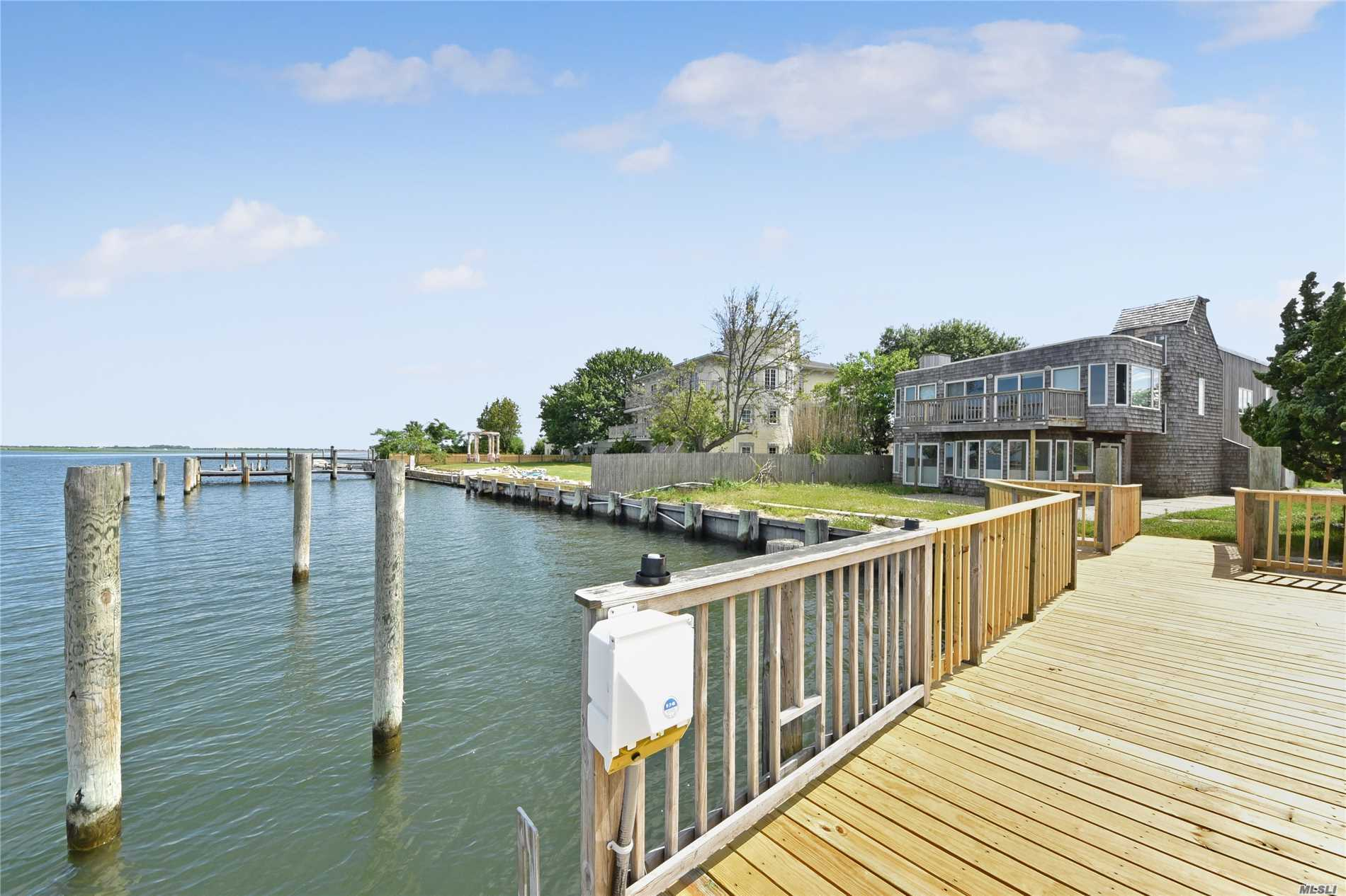 Baldwin. Boaters Dream House!! Amazing 5 Bedroom, 4 Bath House, Waterfront With Magnificent Water Views, Private Floating Dock, Lots Of Amenities, Updated With New Kitchen, New Appliances, Huge Bedrooms, High Ceilings.