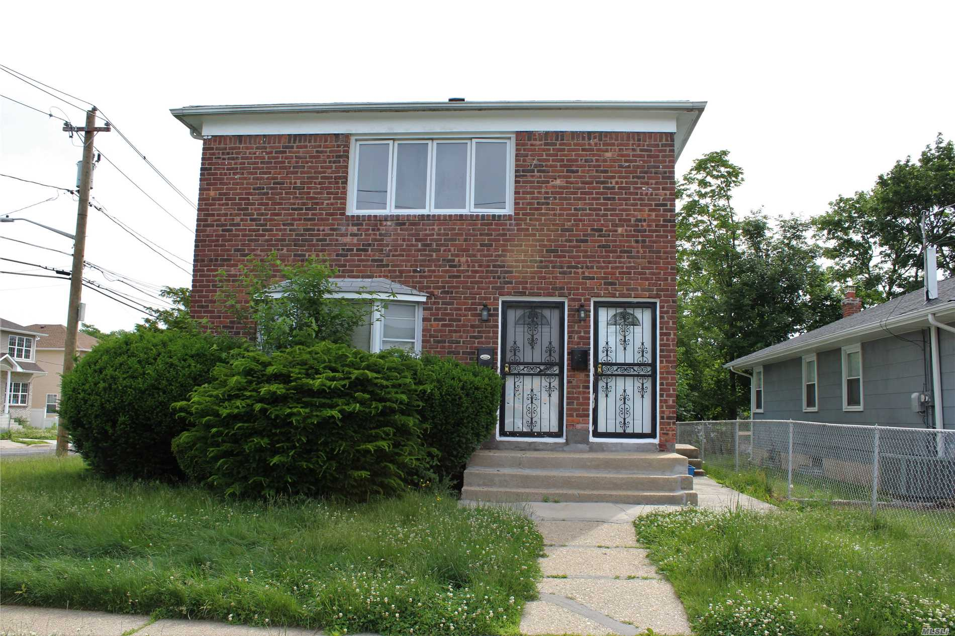 Totally Renovated 2 Family Located In Hempstead, 6 Bedrooms, 2 Full Baths, Ss Appliances , Wood Floors Throughout, Cac Cooling, Full Finished Basement, Private Driveway And Street Parking.