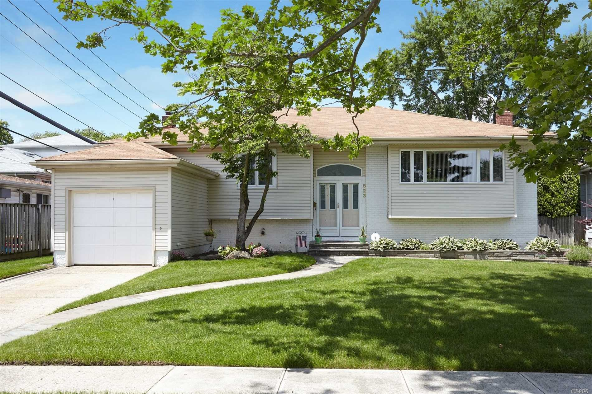 Move Right In To This Sunny & Spacious 4 Bedrm 2.5 Bth Home Located On Lovely Tree Lined Quiet Street In N.Woodmere , Sd#14. This Beautifully Renovated And Maintained Home Has Low Taxes, Hw Flrs, Cac, And 2 Zone Heat. Flr, Fdr, Masterbdrm Suite W/ Bth, Lg Fam Rm W/ Fplc, Lg Rear Patio. Great Flow For Entertaining. All Systems!