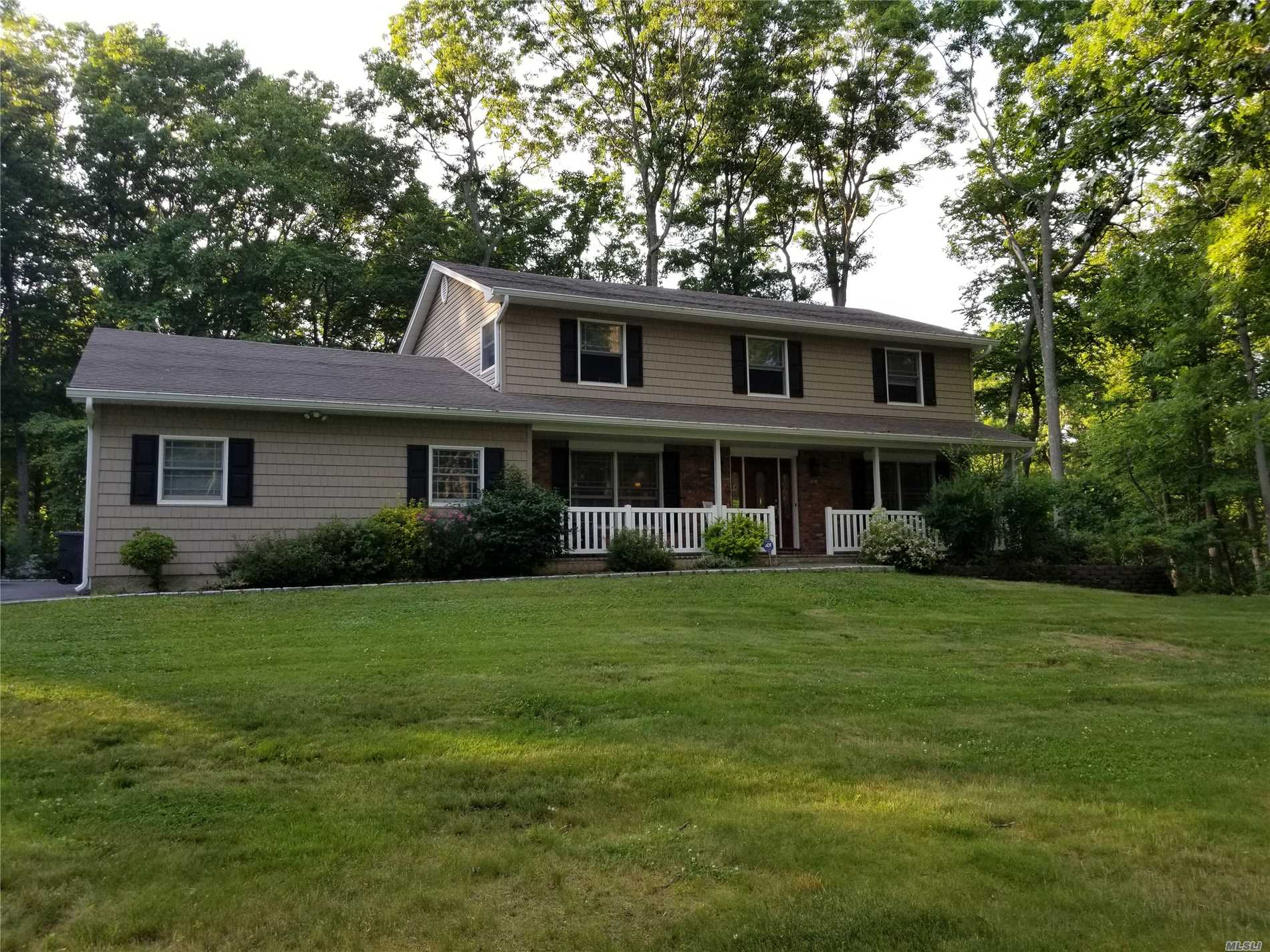 Beautifully Maintained Colonial In Tree Lined Neighborhood With Updated Windows, Siding, Bathrooms, Oil Burner. Flat Property With Trex Deck And Room For A Pool. This House Has Hardwood Floors Throughout, Cherry Kitchen And Granite Countertops.