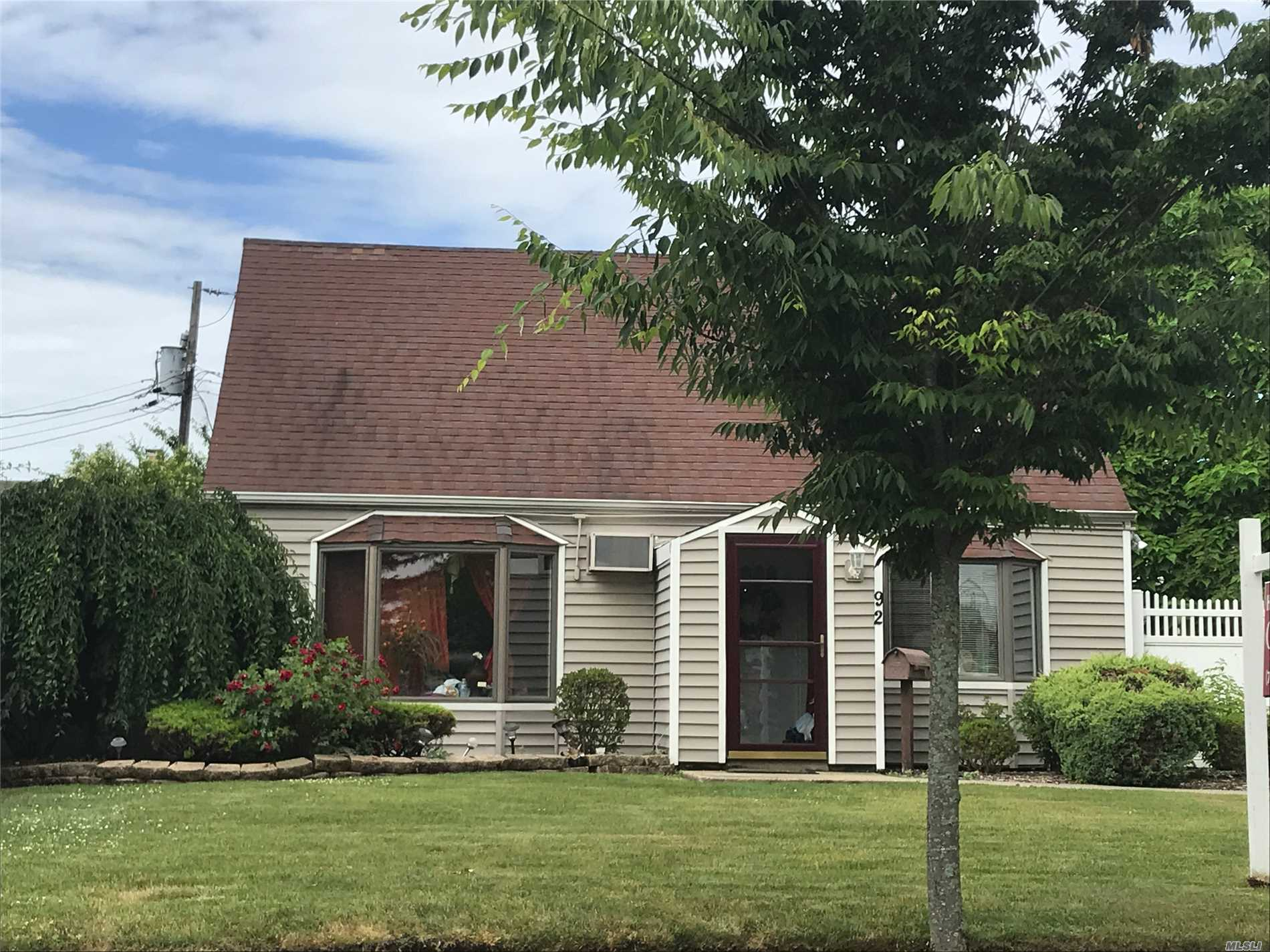 Beautiful Expanded Cape In Levittown For Sale Features 3 Bedrooms, 2 Full Baths, A Granite & Stainless Steel Eat-In-Kitchen W/Cherry Cabinets, Living Room, Dining Room, Huge Family Rm W/Access To Yard. Separate Laundry Area, Entry Foyer/Mud Room, Updated Burner, Windows, Siding, 2Paver Patios. Private Driveway. A Must See!