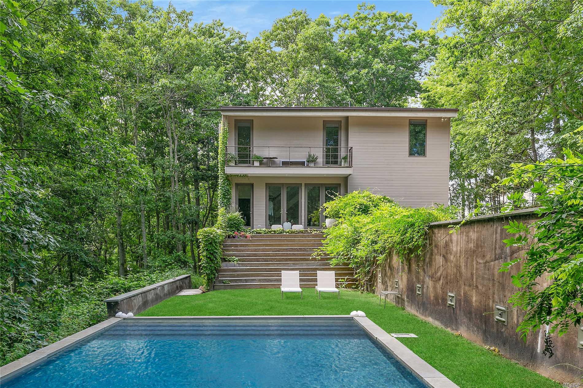 Simply Perfect Modern On Very Private Acre. Open Living Room, Dining Room And Eat-In Kitchen. W/Dramatic Glass Walls. Overlooking A Spacious Mahogany Dining Deck In The Treetops. Master Bedroom En Suite With Balcony. Three Additional En Suite Bedrooms, Two Lead To Pool. Inground 18X36 Gunite Pool & Outdoor Shower. One Of The Highest Elevations On Shelter Island. Near Beach, Dining, Golf.