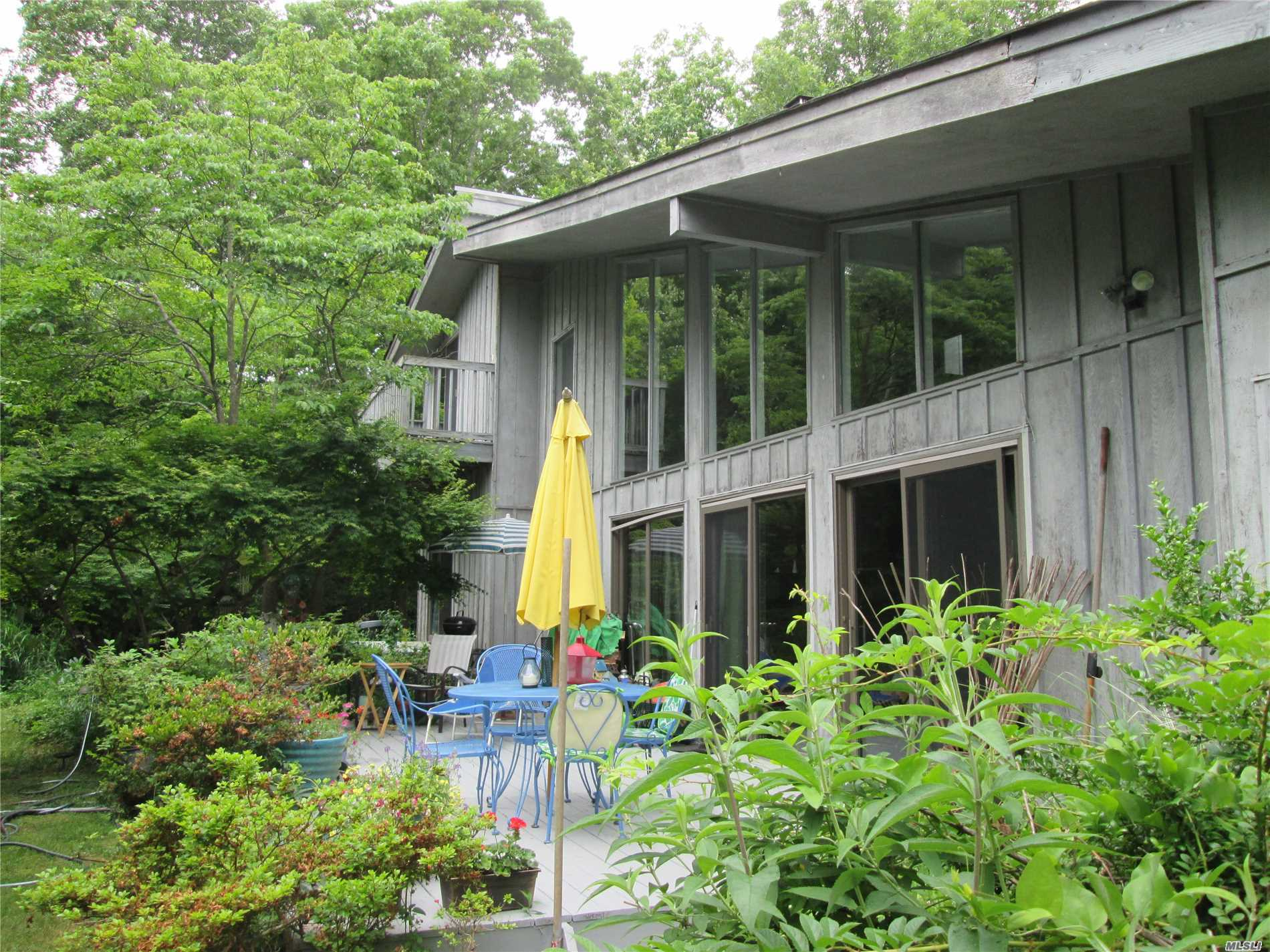 Location, Location, Location!! Stroll To The Quaint Village & The Ferry From This Private & Idyllic Setting South Of South Country. This 4 Bedroom 2 Full Bath Open Flr Plan Contemporary Style Home Awaits Your Arrival. Sun Filled Rooms From Large Custom Windows, Hdwd Flrs, Lg Fplc, New Cac, Ss Appl's, 1 Car Gar., Solar Panels & So Much More! Don't Miss This Opportunity & Take Advantage Of All The Amenities The Village Has To Offer; Golf, Shopping, Private Beach & Restaurants. Come See For Yourself!