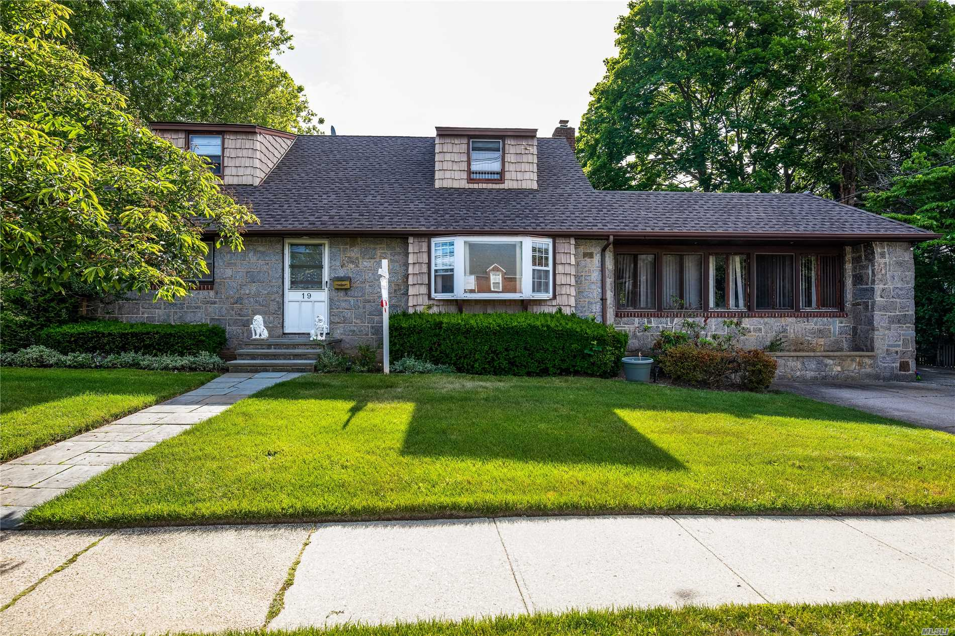 Beautiful Field Stone Dormered Cape With 4 Spacious Bedrooms/2.5 Bathroom, Oversized Family Room, Hardwood Floors, Full Finished Basement. Inground Sprinklers. Great Location. Best Value In Rockville Centre.