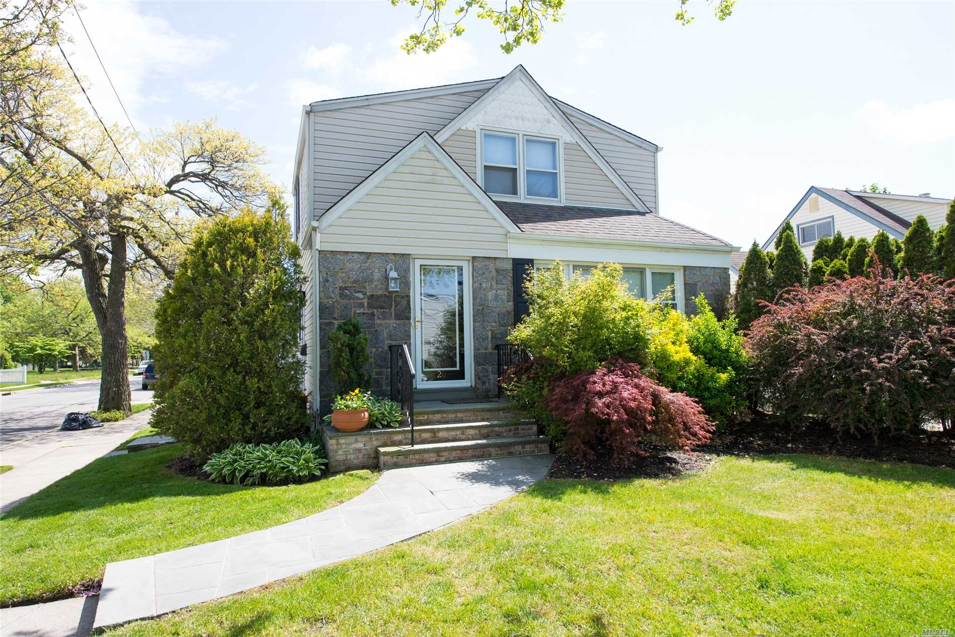 Nicely Updated Cape In Convenient Location Close To Lirr Shopping, & Highways. 3 Large Bedrooms, 2 Full Bths, Wood Floors, Oil Heat, Gas Cooking,  All Fenced Rear Deck. 1 Car Garage W/ Driveway, Must See!! Tenant In Basement Apartment With Separate Entrance. Use Of Partial Basement And Shared Laundry Room. Landlord Pays Landscaping And Water.