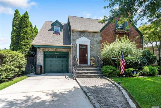 Wonderful Tudor Style Home In Beach Community. Beautiful Hardwood Floors, Updated Kitchen, Granite Counters, Large Living Room With Fireplace, Updated Roof, Formal Dining Room, Beautiful Property With Water Views, Walk To Beach. Private Beach Rights