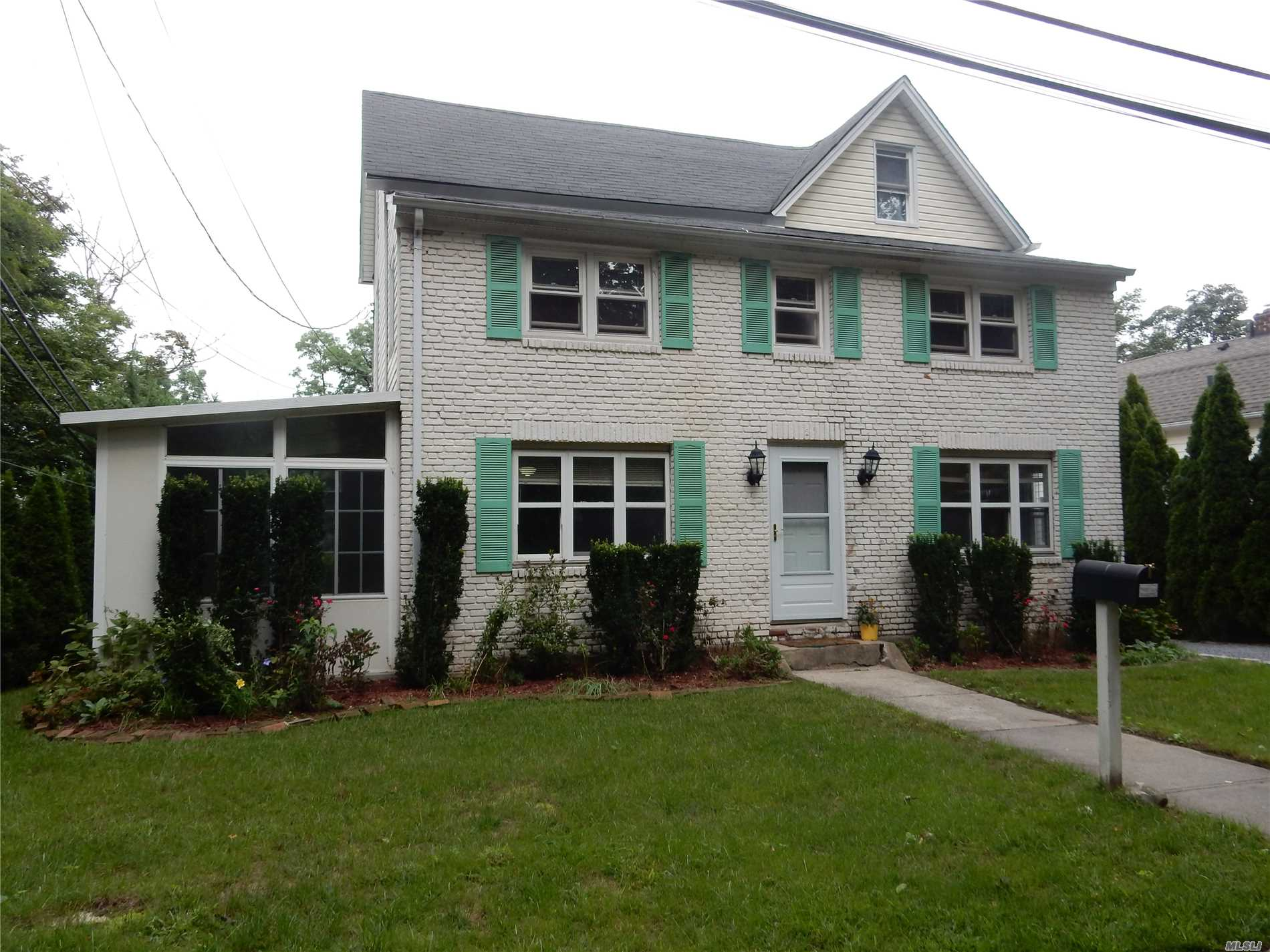 Sunlit Brick Colonial 3 Bedroom, 2 Full Baths. Living Room, Office/Den. Sunporch W/ Sliders To Yard And Outside Entrance To Deck Off Of Eat In Kitchen W/ Stainless Steel Appliances. Washer & Dryer On 2nd Floor. 2 New A/C Window Units. Beautifu Yard. Off Street Parking-Driveway For 2 Cars. Convenient To Lirr, Parks, Library, Town, Etc.