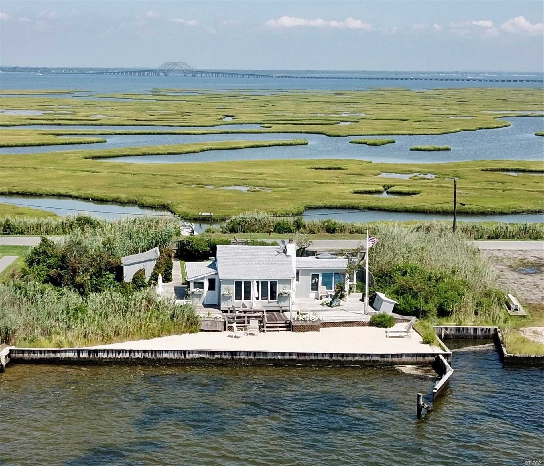 Lovely Summer Home Within The Captree Island Community! Peace And Tranquility Will Flow Over You From Your Private Waterside Deck. Amazing Channel & Bay Views Captivate The Experience Of This 1, 600 Sqft Beach House Lifestyle With Tons Of Natural Light Featuring Hardwood Floors, Artisan Well, Plenty Of Storage Along With Parking For Up To 6 Cars, 100Ft Bulkhead