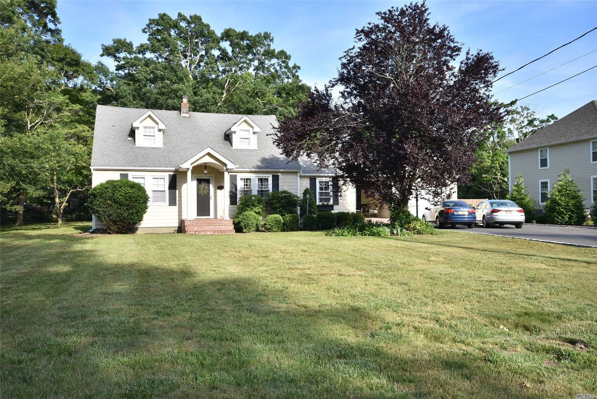 Spacious Cape Style Home On Large Park Like Property With Detached Two Car Garage And Attached One Car Garage. Taxes After Nys Star Rebate Are $11, 294.38.