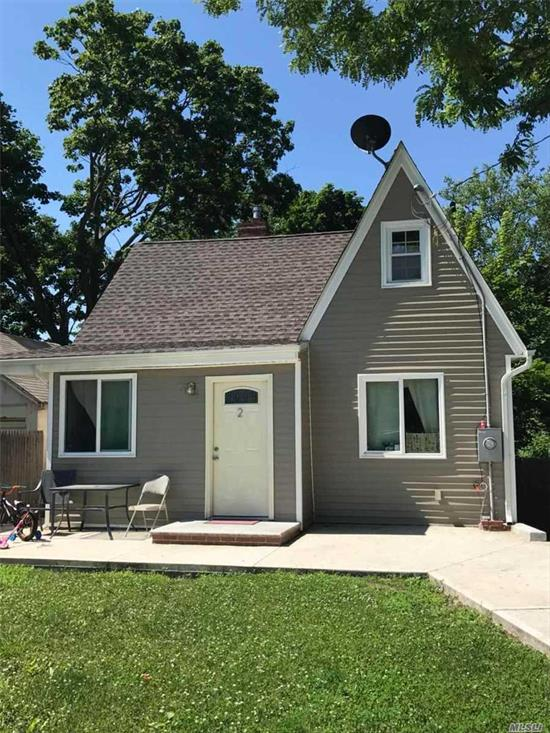 This House Has Been Fully Renovated. Everything Is New. New Hot Water Heater, New Boiler, New Appliance, Now Roof, New Siding, Ect. Huge Back Yard, Lots Of Potential.