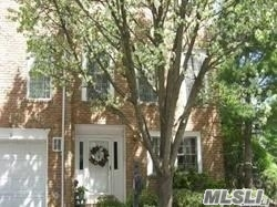 Pristine 3 Bedroom Townhouse With 2 Full Bathrooms & 2 Half Bathrooms. Unique End-Unit With Private Deck Off Kitchen And 1.5 Car Att. Garage. Great Location. Convenient To Town And Lirr.