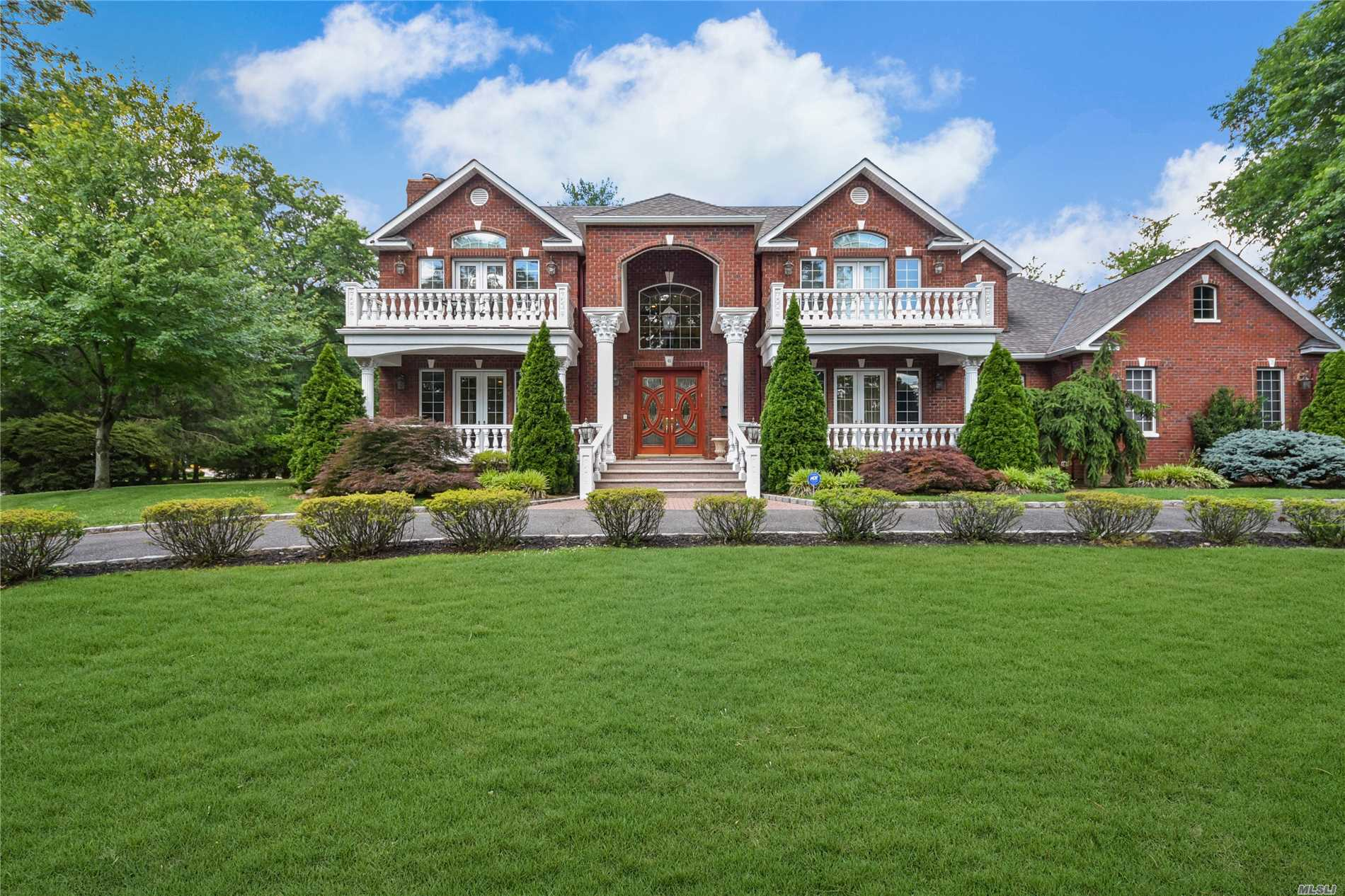 Roslyn Heights Country Club, Builder's Own Home! Elegant & Spacious Custom Brick Colonial W/ High Ceilings, Featuring Semi Circular Driveway, Welcoming Porch & Romantic Balconies, 10 Ft Ceilings, Elegant Millwork & Paneling Throughout, 6 Generous Size Br, Radiant Heat, Mahogany In-Lay Floors, Surround Sound, Custom Fitted Closets, Chef's Kitchen W/ Custom Crafted Cabinetry & Cappuccino Machine.Mstr Ste W/Fpl, Sit Rm/ 7th Br, Steam Shower, Make Up Vanity/Sitting Area Massive Lower Level W/Ose.