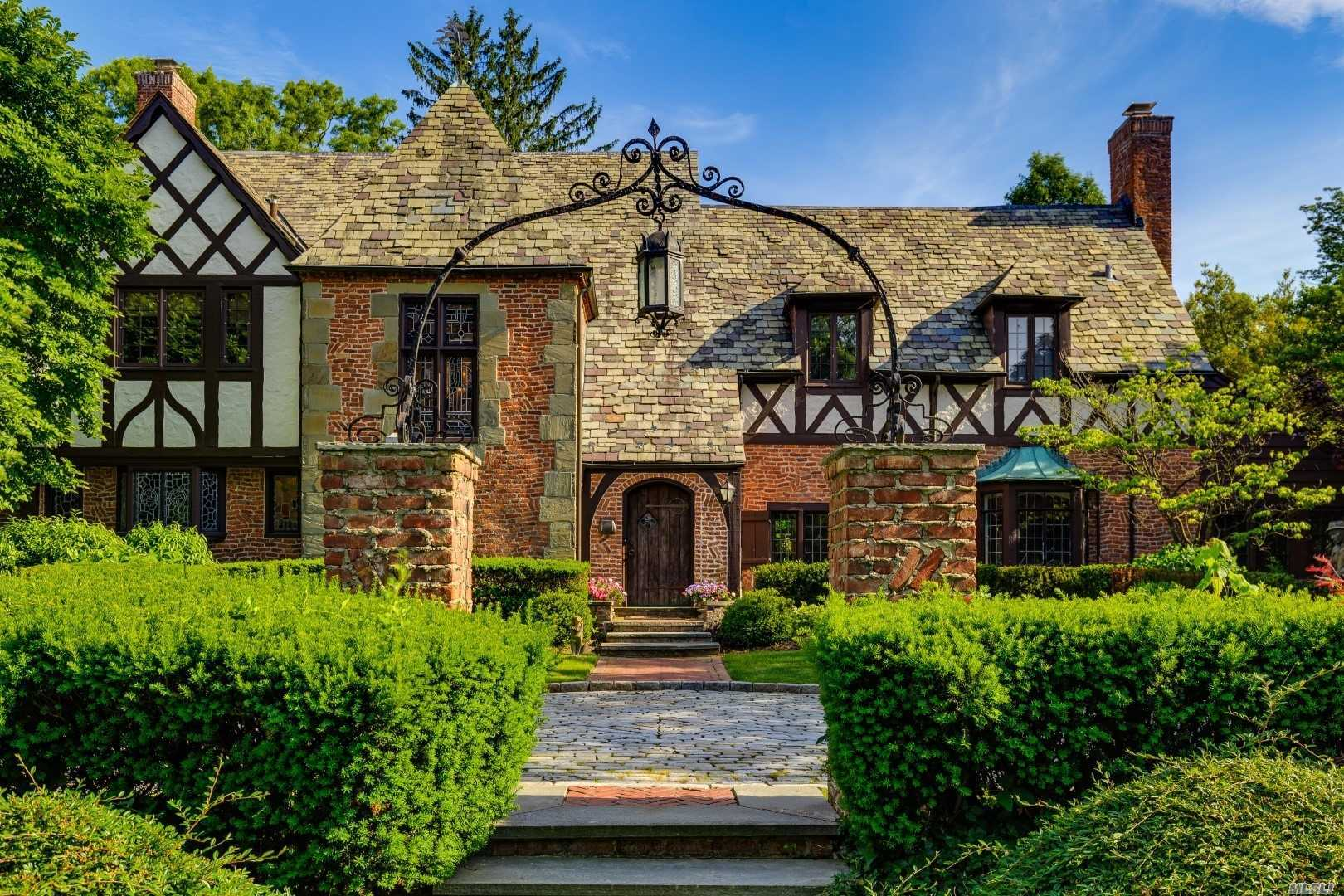 Rare Offering!! Giant English Tudor Manse In Prestigious Windsor Gate Cul De Sac W/ Private Park.  Majestic Features Include High Ceilings, Large Rooms, Staff Wing, Exposed Brick, Artisinal Stained Glass, Lush Grounds W/ Bricked Patios.Recent Mint Renovation! Fireplace, Separate Living + Family Room, Den, Glass Cathedral Breakfast Room, Renovated Chefs Kitchen, Luxe Master And Bath W/ Extensive Closets, Sunroom, Windowed Basement W/ Bar. Private Golf, Pool, Police, Day Camp, Tennis, A+ Schools