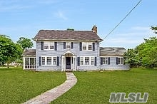 Own A Piece Of Paradise In The Gracious Colonial With Spectacular Views Of The Beautiful Moriches Bay & Dunn Road. Hardwood Flooring Throughout This Spacious & Inviting Home Thats Filled With Old World Charm Throughout Every Room. Call Today To View This Very Unique & Rare Find Set On Over An Acre Property, One For Sure Not To Miss If Older Homes With A View Is Your Love.