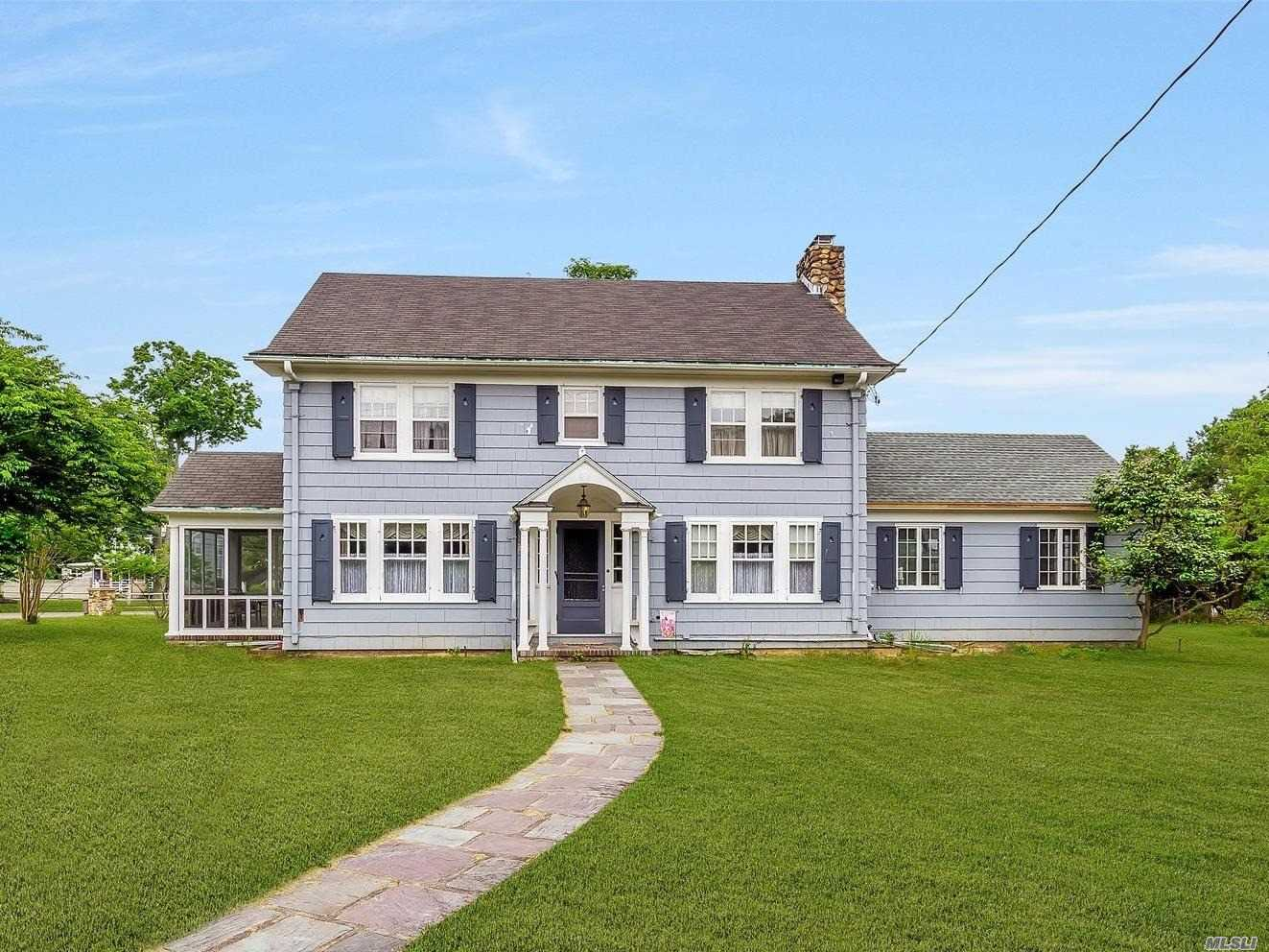 Own A Piece Of Paradise In The Gracious Colonial With Spectacular Views Of The Beautiful Moriches Bay & Dune Road. Hardwood Flooring Throughout This Spacious & Inviting Home Thats Filled With Old World Charm Throughout Every Room. Call Today To View This Very Unique & Rare Find Set On Over An Acre Property, One For Sure Not To Miss If Older Homes With A View Is Your Love. No Flood Insurance Needed Here. Lots Of Potential!