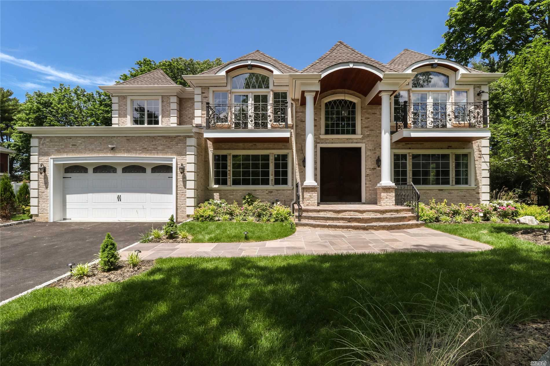 Roslyn Heights, Country Club. Stunning Open & Spacious 2017 All Brick Colonial Offering 6 Bedrooms, 5.5 Baths, Finished Basement W/ Full Bth, Hi Ceiling & Separate Entry Way From Backyard. Generator, Wired As A Smart Home For Security Camera/Stereo & Remote Wifi Enabled Key-Less Entry. Custom Built Chef's Kitchen W/ Viking Appliances, Customized Paneling, 60 Freezer/Refrigerator. Designer Master Bth W/ Make Up Vanity, Over-Sized Backyard & Patio With Option To Build A Pool (Plans Approved).