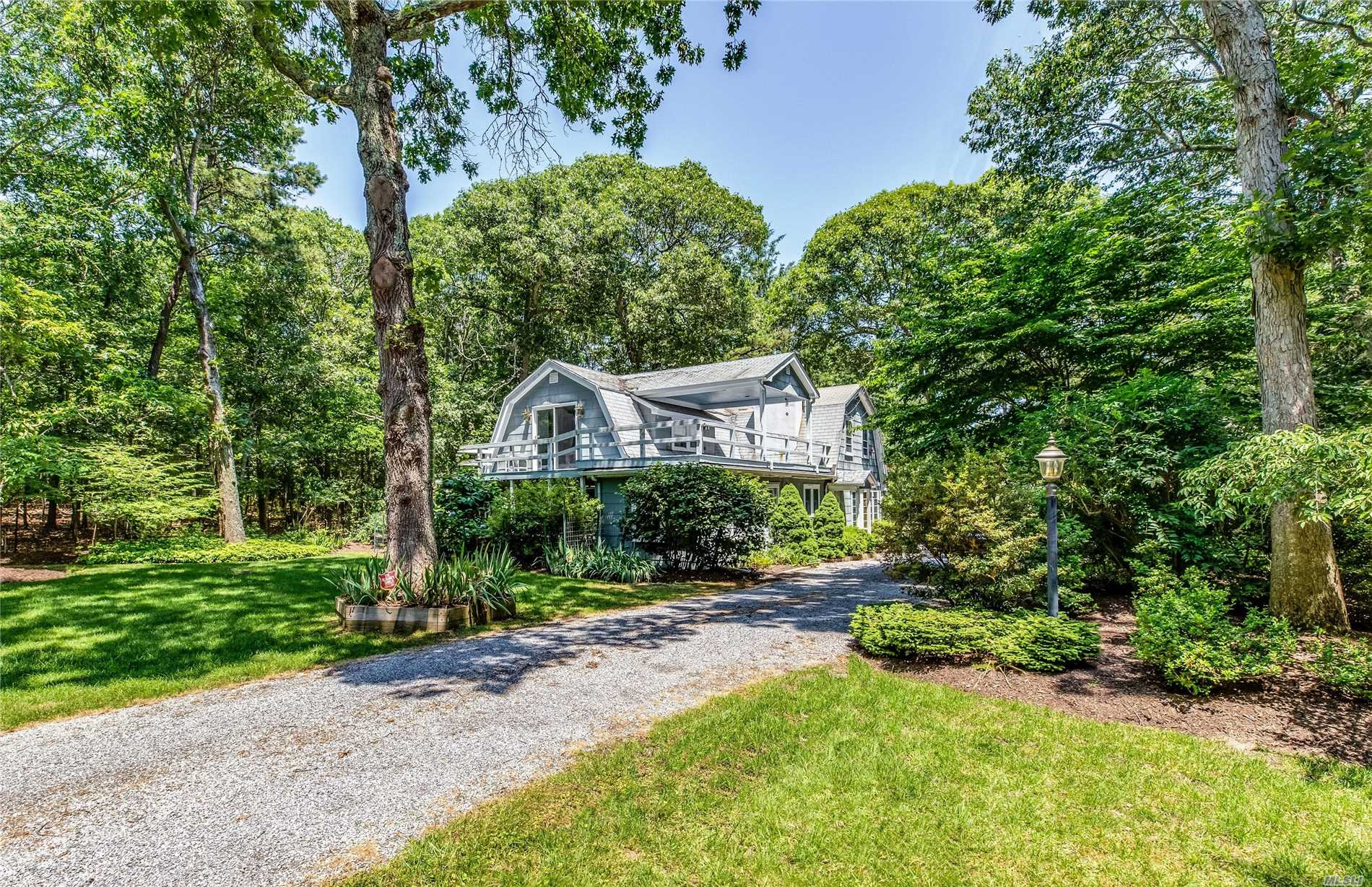 Lovely Gambrel-Roof Two Story Home On .63 Acres Close To Private Nassau Point Bay Front Beach. Master Suite On First Floor, 2 Bedrooms And Bath On Second Floor. Home Has Some Original Features Of 1920'S Chalet-Style Home That Has Been Redesigned And Enlarged. Large Great Room, Eat-In Kitchen And 3-Season Porch. Nicely Landscaped With Mature Plantings.