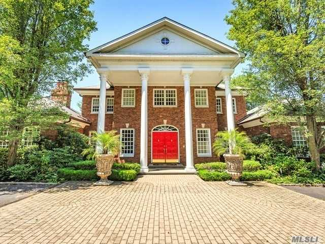 Elegant All Brick Center Hall Colonial Features 4 Brs + Guest Rm And 5.5 Baths Situated On A 2 Acres Park Like Ground. Swim.Pool, Hot Tub.3 Heated/Ac Oversized Gar. Height To Fit A Car Lift If Needed. Dan W/ State Of The Art Home Theater. Stately Rm W/Frpl Perfect For Grand Entertaining. Exquisite Woodwork In Library, Staircases Railing & Molding Thru-Out The House. Master Ste W/Frpl & Br Size Closet. Full Finished Basement W/Ose. Taxes Are Being Professionally Grieved. Jericho School District.