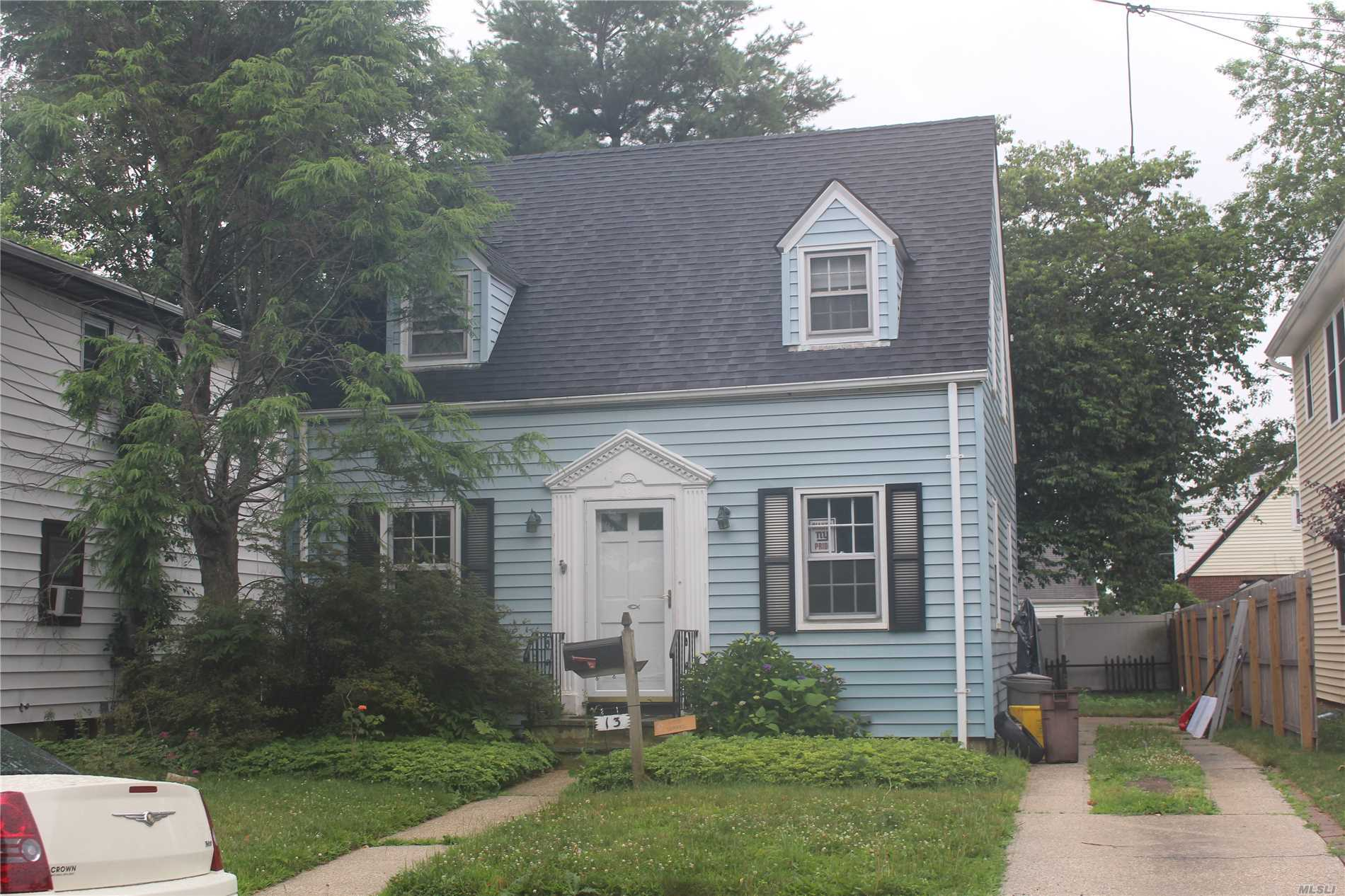 Cute Cape Cod In A Great Location. Close To Lirr To Be Sold As Is