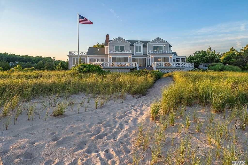 Quintessential North Fork Beach House. 240 Feet Of Gorgeous Sugar Sand Beach. Extraordinary Vantage Point Offers Over 180 Degree Views From New Suffolk To Mattituck And The South Fork. Understated Elegance And The Layout Is An Entertainer's Dream With Kitchen, Eating Area And Living Room With Fireplace, All Open To Each Other And All Facing Peconic Bay. Wednesday Evening Sailing Races Around Robins Island Has A Front Row Seat!