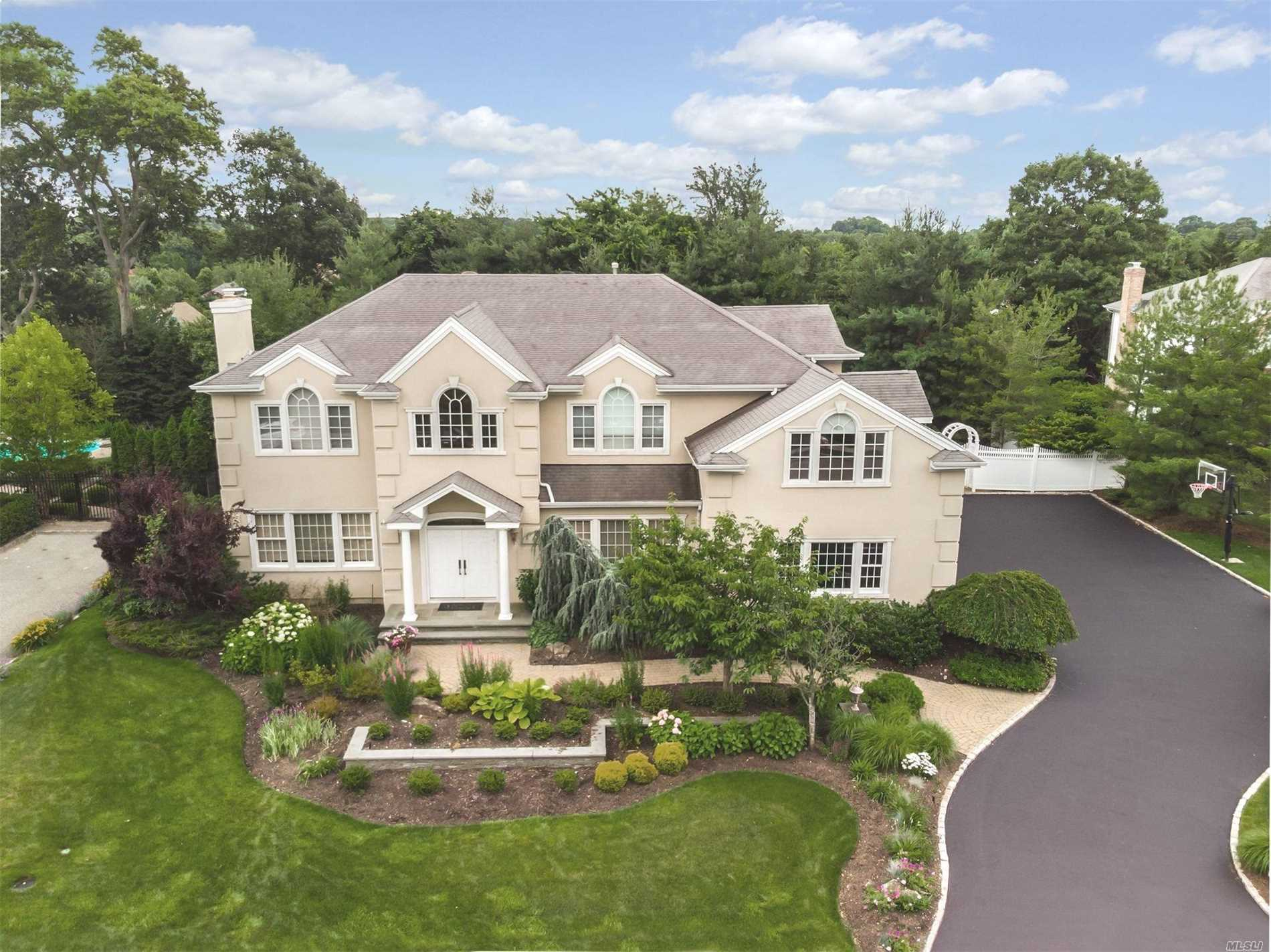 Stunning 5+Bed Hampton Inspired Stucco Colonial Built With The Finest Craftsmanship & Materials To Create A Home Of Sophisticated And Timeless Design.Dramatic 2Story Entry, Open Floor Plan, Wide Hardwood Plank Flooring Throughout.Professional High-End Chef's Kitchen With Custom Butlers Pantry, Banquet Dr, Oversized Gas Fplce In Lr, Mahogany Entertainment Built-In, Marble Spa Baths, Heated In-Ground Gunite Pool With Rock Waterfall Surrounded By Lush Landscaping. High Ceilings On All Floors, 3 Car Garage.