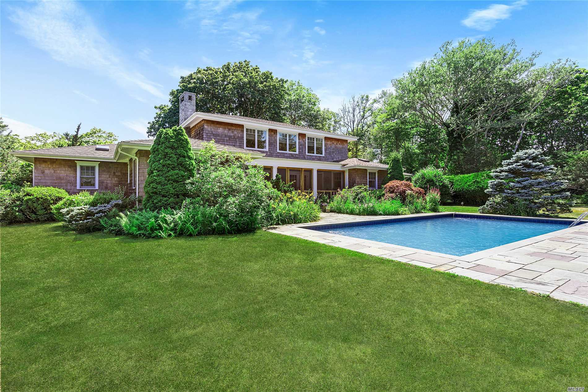 This Five Bedroom Traditional Is Sited On 1.6 Acres Of Lawn With Beautiful Gardens And Offers Privacy In The Estate Section Of Quogue Village. An Inviting Foyers Leads To A Spacious Living Room With A Charming Fireplace. A Formal Dining Room And Eat-In-Kitchen Open To A Screened Porch. The First Floor Offers Four Bedrooms And 2.5 Baths. The Second Floor Master Suite Has Its Own Sitting Area With An Additional Tv Room Or Office. A Beautiful Heated Gunite Pool Completes The Landscape.
