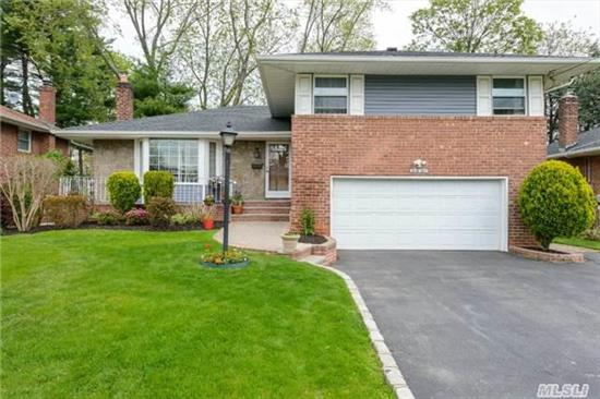 A Wonderful 3 Bedroom Split Level With 2.5 Baths/Formal Living Room With Formal Dining Room- Large Kitchen/Hardwood Floors Throughout- Den/ Full Basement With A 2 Car Garage With Interior Entrance From The Garage To The Den. Gas Heat-Central Air Conditioning//Mid Block- A Must See !