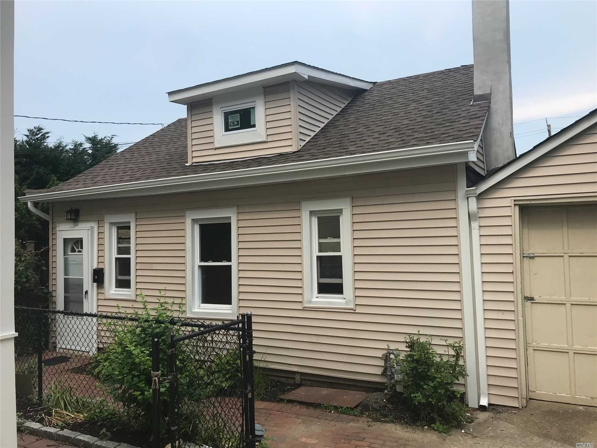 Totally Renovated Cottage - Kitchen Has Brand New Oven And Fridge, Granite Countertops, And Beautiful Stone Floor - Wood Floors And New Windows Throughout - 2 Ceiling Fans. Close To Grocery Stores, Laundromat, Restaurants. Very Private Space With Private Entrance. Bonus Walk-Up Finished Attic. Tenant Pays 1 Month Total Broker Fee.
