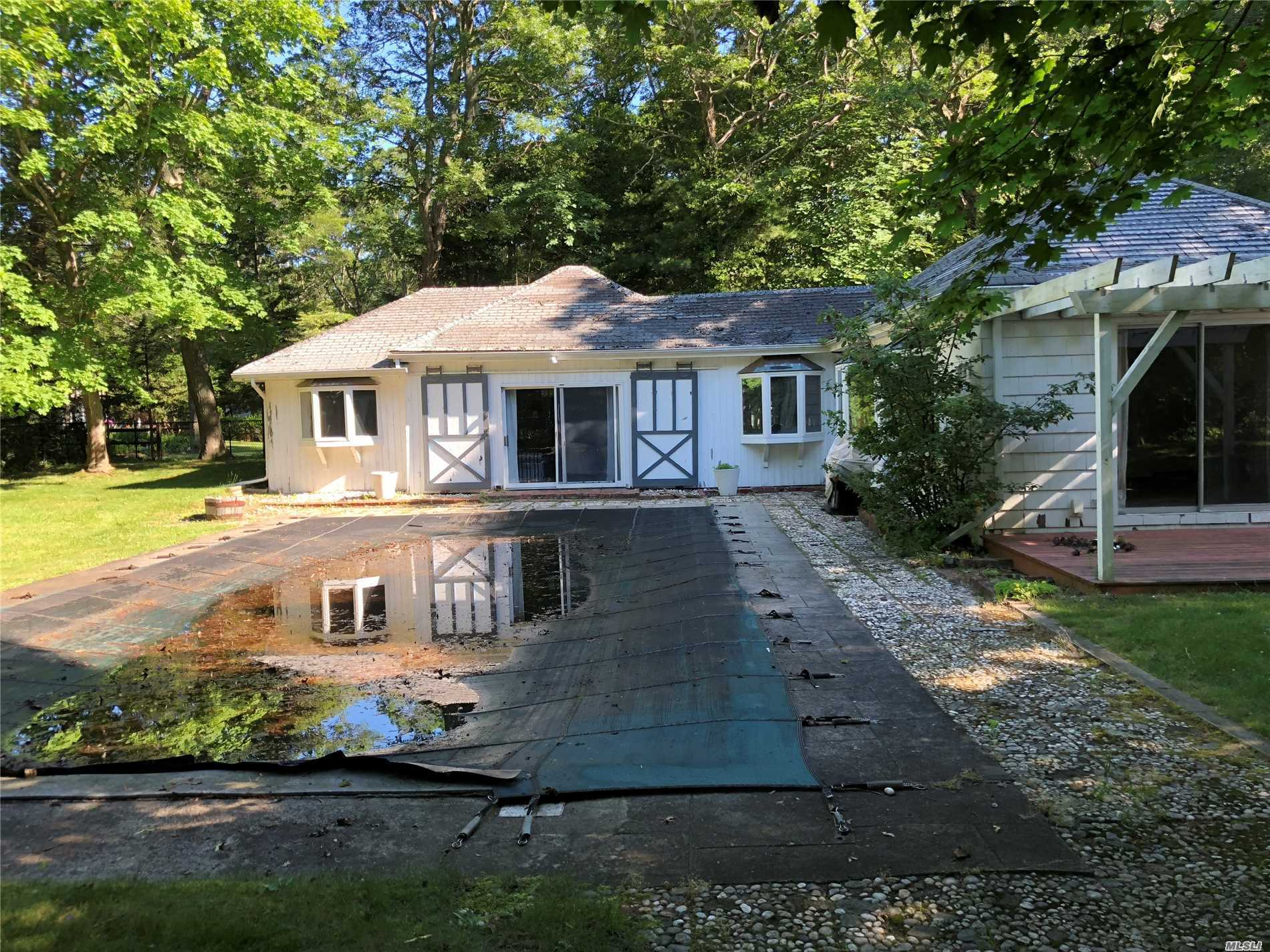 This Photo Is The Pool House Which Has 1400 Sq Ft. The Main House Is The Second Photo Which Has 2400.The Pool Is 20 X 40. This Property Is 0.85 Of An Acre In A Beautiful Secluded Location Near Np Private Beaches.. The Main House Is In Need Of Structural Repairs & Renovations. The Pool House Is Also In Need Of Renovations. We Have C Of O's For Both Structures . This Is The Least Expensive House For Sale On Np. This Is A Great Opportunity To Customize These 2 Structures To Suit Your Needs.
