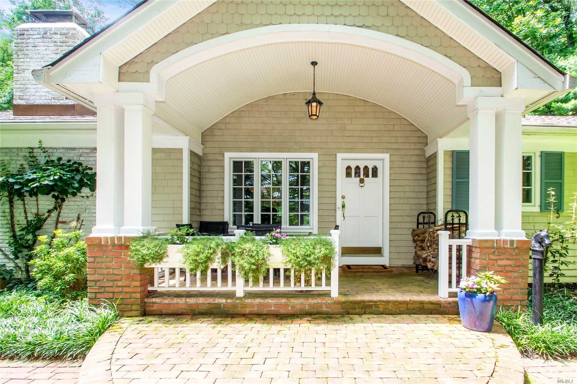 Privately Situated On 2 Acres, This Beautiful Home Features A Formal Living Room With A Cozy Fireplace, Formal Dining Room, Eik, Updated Baths, Hardwood Floors,  New Roof, And New Hwh. Gorgeous Gardens Designed By Dodds & Eder Surrounds The Nature And Serenity. Bluestone Patio W/ Hot Tub Addd To Great Entertaining Fun. A Fabulous Private Beach, Mooring Rights & Ramp Add To The Adventure Of Living In Cove Neck.