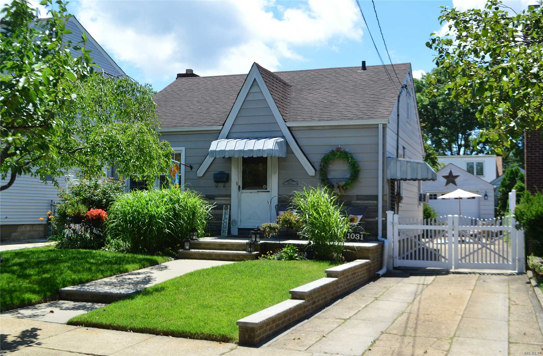 Lovely 2 Br Cape Featuring Living Room, Eat-In Kitchen, Formal Dining Room, New Bath, Office W/Ose, Walk-Up Loft/Attic, Full Basement W/Ose, Hw Floors, Front Porch, Back Patio W/Awning, Det 1.5 Car Garage.Taxes Currently $11, 467.17, And Are Being Prof. Grieved. Expected Reduction Approx 2500-2800!New Dryer, Newer Washer, Arch. Roof 2003, Vinyl Replacement Windows 2005, Garage Door 2015, Fence 2016. Transferable Terminex Contract, Heating Service Contract W/Slomins, Lawn Service Paid Through Oct.