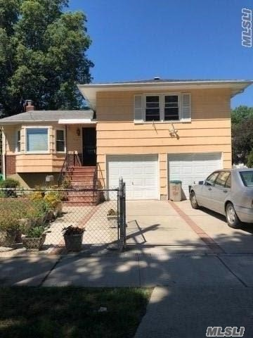 Beautiful Split Features 4 Bedrooms, 1.5 Baths, Lr, Fdr, Eik, Full Finished Basement, 2 Car Attached Garage, And Huge Lot! House Has Tremendous Potential! Great For A Large Family And Close To All!!!!