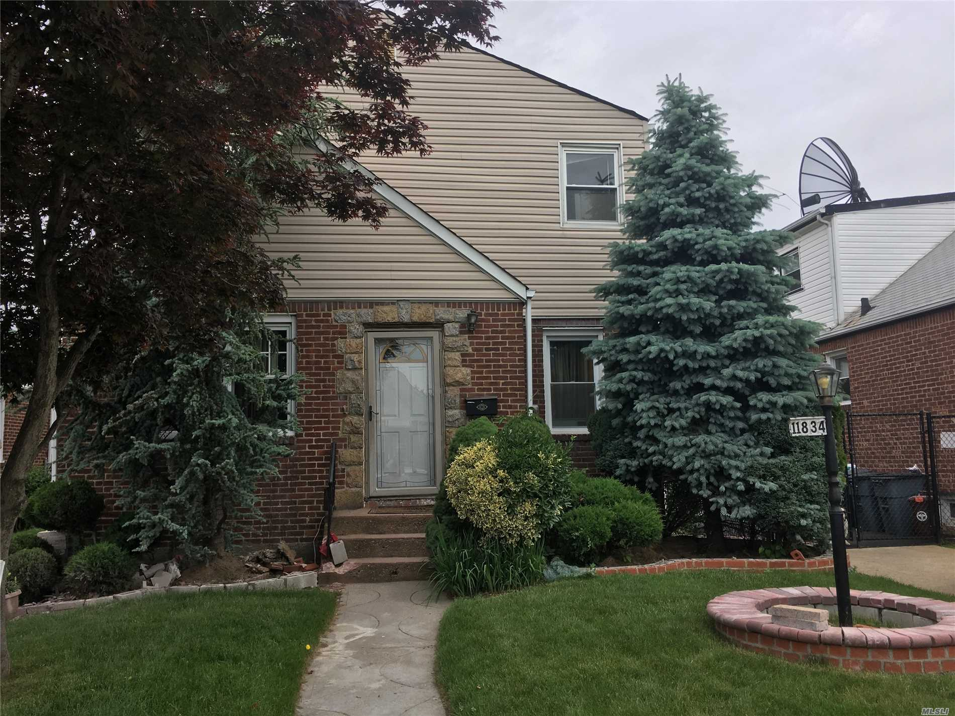 One Of A Kind Home In Cambria Heights- Desirable Neighborhood - Mother/Daughter Set Up - 2 Bedrooms Up And 2 Bedrooms Down- You Could Live Mortgage Free - Finished Basement With 2 Rooms And Outside Entrance- Well Maintained Home - Professionally Landscaped