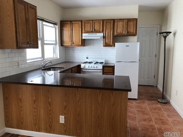 Beautiful Bright Completely Renovated Conveniently Located Near Shopping , Restaurants, Close To All Major  Highways, And Transportation,  To Buses Just 1/2 Block 3 Blocks To Lirr.