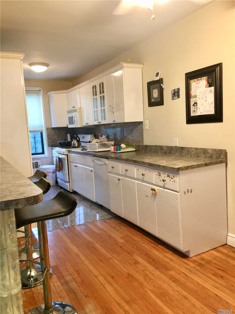 Designer Eat In Kitchen Featuring Custom Breakfast Bar, Gorgeous Hardwood Floors, Updated Bathroom, Window In Kitchen, Spacious Rooms, Loaded With Closets, New Doors, Pool, Super On Premises, Close To Shops & Transportation