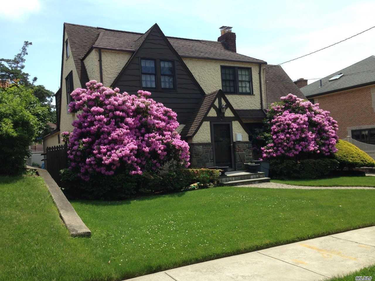 Rare Find Elegant Tudor Nestled On A Unique Location Of Douglaston Park Surrounded By Mansions Features Living Rm.With Fire Place Formal Dr. Eik. 4 Bds 1.5 Bths Beautiful Hardwood Floors Private Backyard Convenient Located To All Major Highways , Shopping, Restaurants Close To Buses & Li Rr And Sd # 26