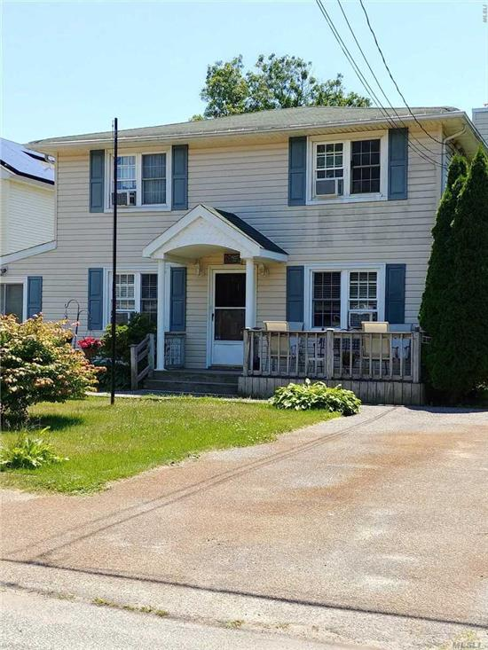 Spacious Colonial Style Home In South Shirley Beach Area-Updated Kitchen And Hvac , Updated Electric To 200 Amp Service 2 Driveways, Walk To The Bay! Owner Relocating -Present All Reasonable Offers! Home Needs Only Paint And Carpet!