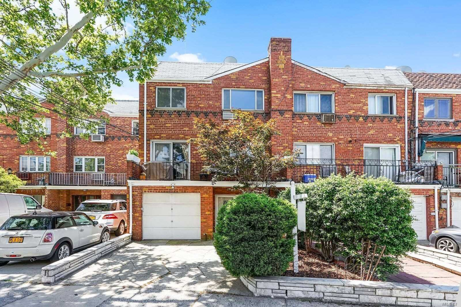 Brick 3 Family Home. Wood Floors, Front And Rear 2nd Floor Balconies, Private Yard, 1 Car Garage, Private Driveway.