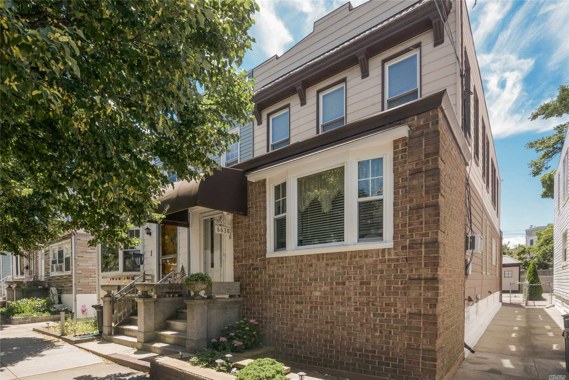 Great 2 Family Semi-Detch'd Home Located In The Heart Of Middle Village. 2 Blks From Juniper Prk. 1.5 Blks To Metro. 6 Rms Over 5, Full Fin Bsmt, Pvt Yard (Fully Cemented Private Yard), Drvwy. Move-In-Condition!